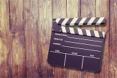 Clap board on wooden background