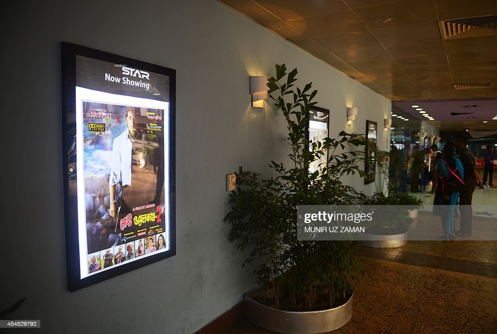 A film poster advertising Bangladeshi film 'Most Welcome 2' hangs in front of a cinema hall at a shopping mall in Dhaka on September 3, 2014. Authorities in Bangladesh have banned local film-makers from giving their movies English titles after a spate of recent Bangla blockbusters with titles such as 'Honeymoon' and 'I Don't Care'. Mushfiqur Rahman Gulzar, general secretary of the Bangladesh Film Directors' Association, said the government had instructed the industry to ensure that all future homegrown releases have Bangla names. AFP PHOTO/Munir uz ZAMAN