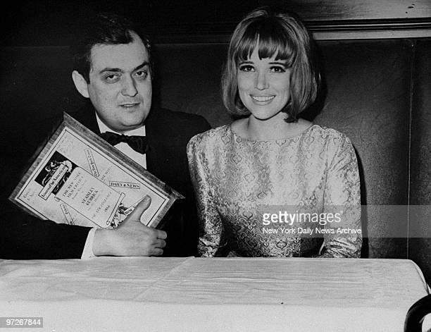 Film producer and director Stanley Kubrick holding his Film Critics Award sits with his wife Christiane at Sardi's West during the Film Critics Award...