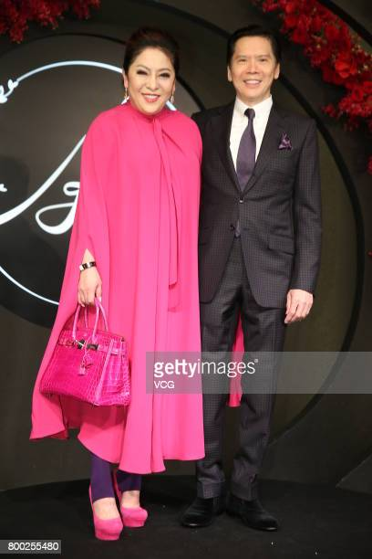 Film producer Charles Heung WahKeung and wife Tiffany Chen arrive at the red carpet of the banquet held by Macau businessman Levo Chan and actress...