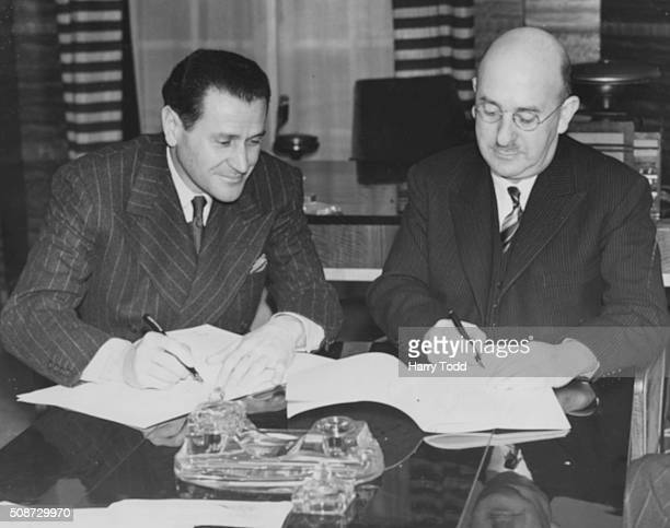 Film producer David Rose of Paramount Pictures signing a contract with Oscar Deutsch of Odeon Cinema's to move control of seven theatres to Odeon...