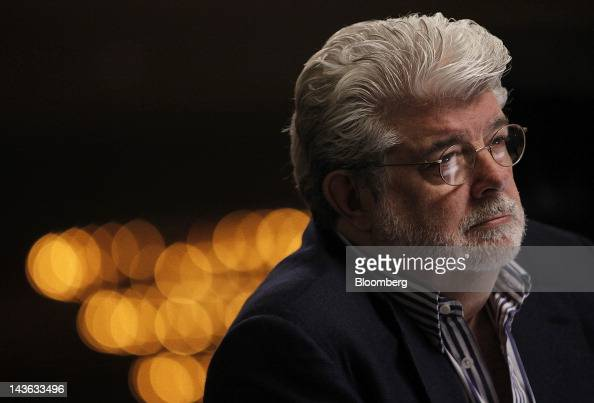 Film producer George Lucas listens during a Bloomberg Television interview at the annual Milken Institute Global Conference in Beverly Hills...
