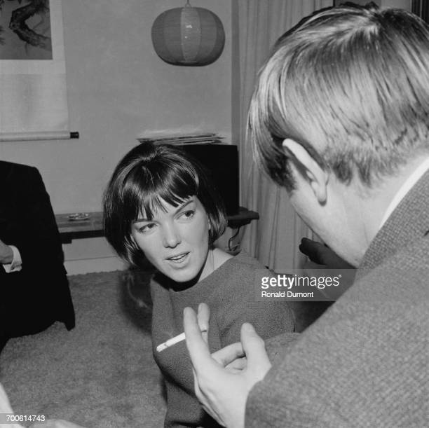 Film producer Peter Prowse talks to fashion designer Mary Quant at a party UK 13th November 1960