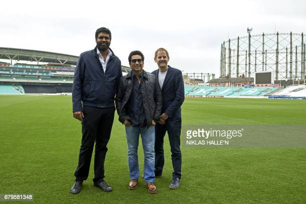 Film producer Ravi Bhagchandka Indian cricket legend Sachin Teldulkar and British movie director James Erskine pose for a photograph during a...