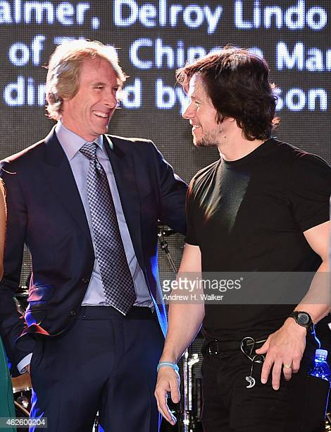 Film producer/director Michael Bay and actor/producer Mark Wahlberg speak onstage at The Giving Back Fund's Big Game Big Give at the home of Erika...