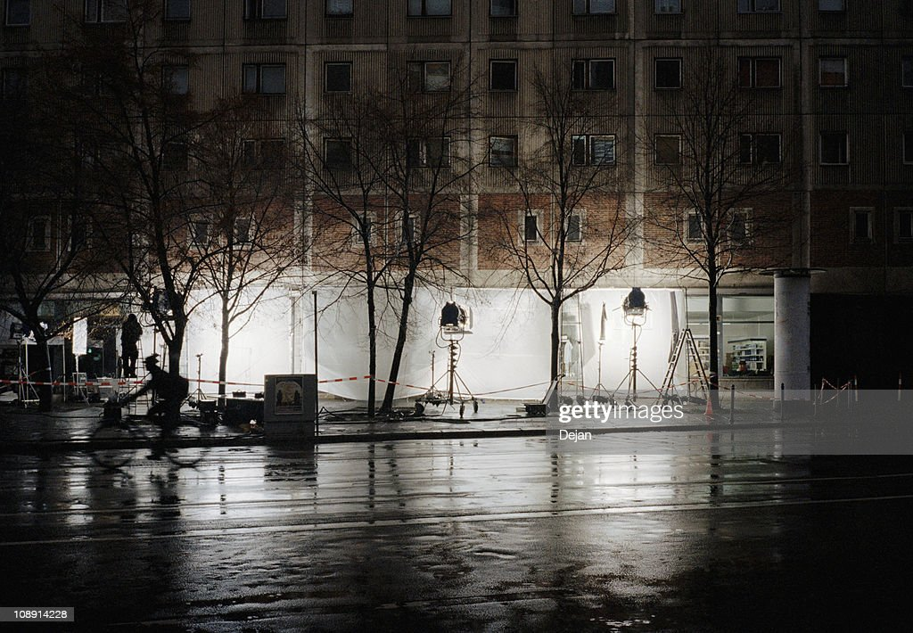 A film set on a city street at night
