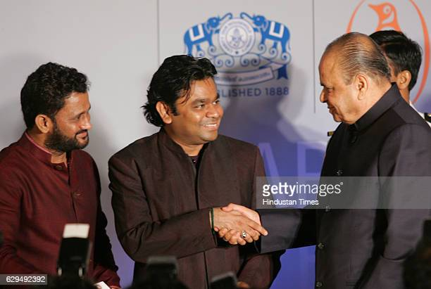 Film sound designer Resul Pookutty AR Rahman and Governor K Sankaranarayanan at the release of Pookuttys autobiography in Malayalam Shabdatharapadham...