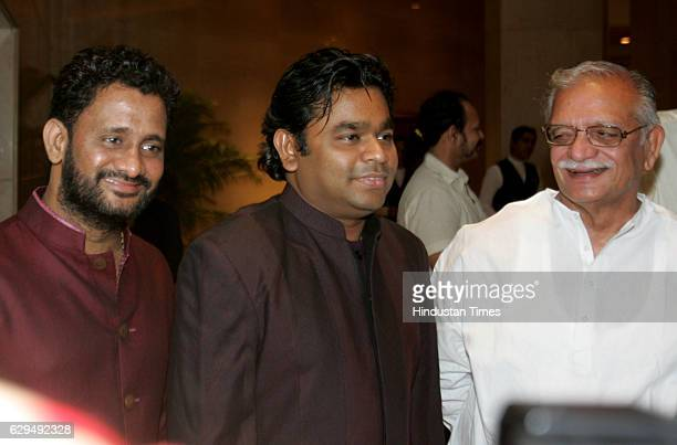 Film sound designer Resul Pookutty AR Rahman and Gulzar at the release of Pookuttys autobiography in Malayalam Shabdatharapadham at a suburban hotel...
