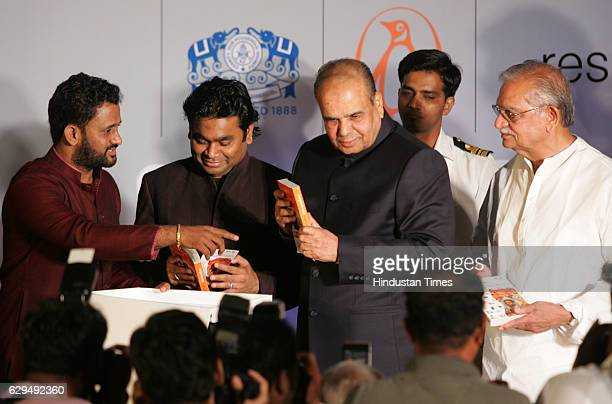 Film sound designer Resul Pookutty AR Rahman Governor K Sankaranarayanan and Gulzar at the release of Pookuttys autobiography in Malayalam...