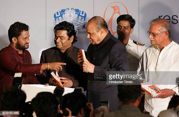 Film sound designer Resul Pookutty music composer AR Rahman Governor K Sankaranarayanan and lyricist Gulzar at the release of Pookuttys autobiography...