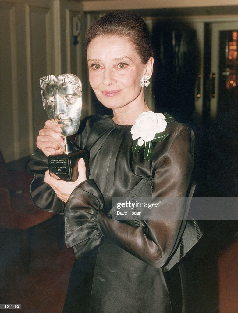 Film star <a gi-track='captionPersonalityLinkClicked' href=/galleries/search?phrase=Audrey+Hepburn&family=editorial&specificpeople=86470 ng-click='$event.stopPropagation()'>Audrey Hepburn</a> (1929 - 1993) with the Special Award she received from the British Academy of Film and Television Arts, 1992.