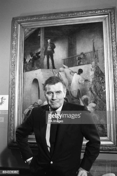 Film Star Charlton Heston with G W Joy's oil painting 'The Death of General Gordon' which was inspired the epic film Khartoum which starred Heston
