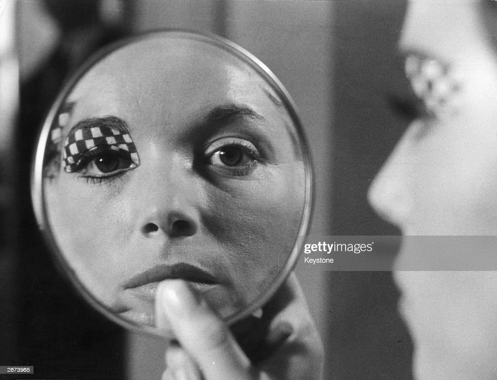 Film star Elsa Martinelli with one eyelid painted in a check design, the face of a woman from the year '2000' ! The concept is by 'Pablo' an Italian 'face designer' working for cosmetic company Elizabeth Arden in New York.