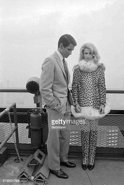 Film star George Hamilton and Baby Jane Holzer jet setter turned movie actress go through a scene of Hamilton's new movie 'Jack of Diamonds' at the...