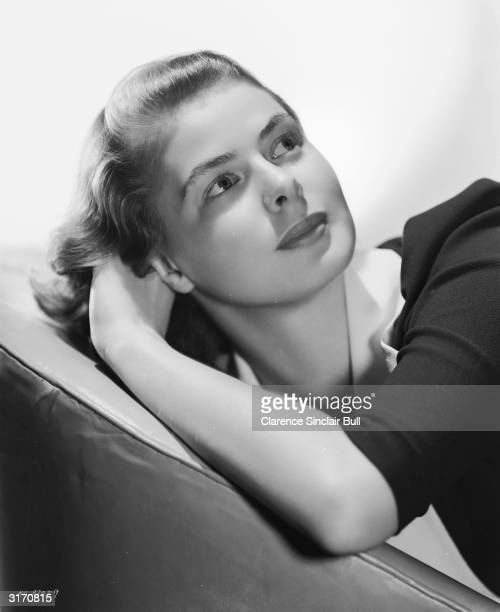 Film star Ingrid Bergman looking young and fresh in a typical Hollywood pose of head resting on her arm as she looks seductively into the distance
