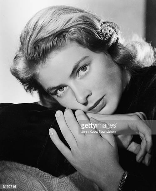 Film star Ingrid Bergman resting her head on her hands