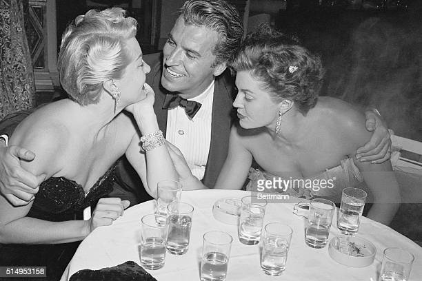 Film star Lana Turner seems to have eyes only for actor Fernando Lamas and vice versa but movie actress Esther Williams concentrates on Lana's...