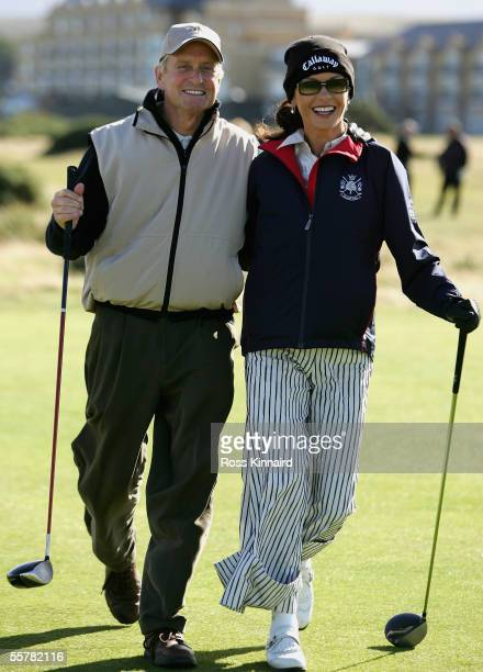 Film Star Michael Douglas and his wife Catherine ZetaJones walk down the 4th fairway during a practice round prior to the Dunhill Links Championships...