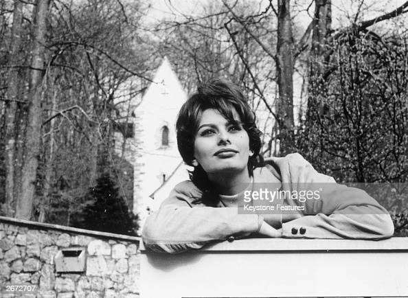 Film star Sophia Loren leans on the gate of her home in Switzerland where she is resting from between films
