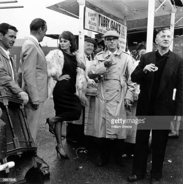 Film star Sophia Loren talking to Dennis Price on location in Arthur Street London EC3 for the film 'The Millionairess'