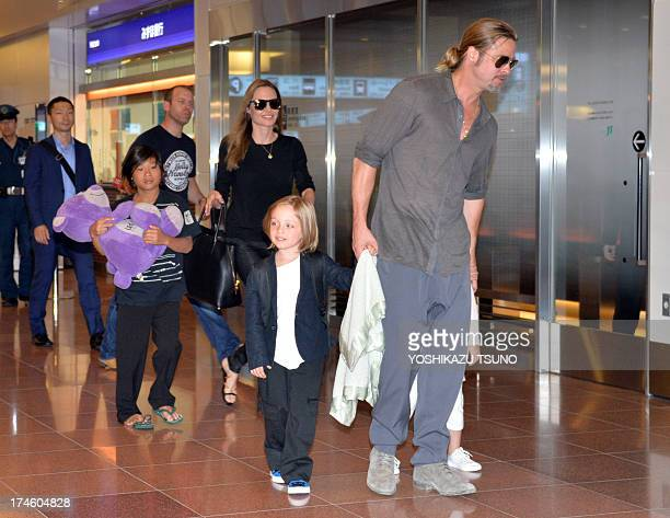 US film stars Brad Pitt and Angelina Jolie accompanied by their children arrive at Haneda International Airport in Tokyo on July 28 2013 Pitt is now...