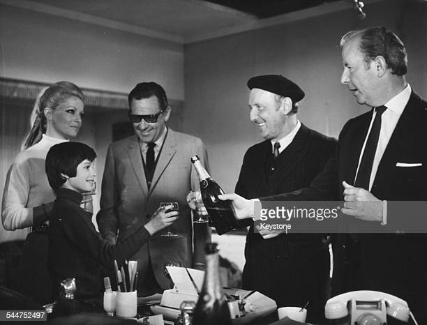 Film stars Brook Fuller Virna Lisi William Holden Bourvil and Terence Young celebrating in the studio in Nice France 1969