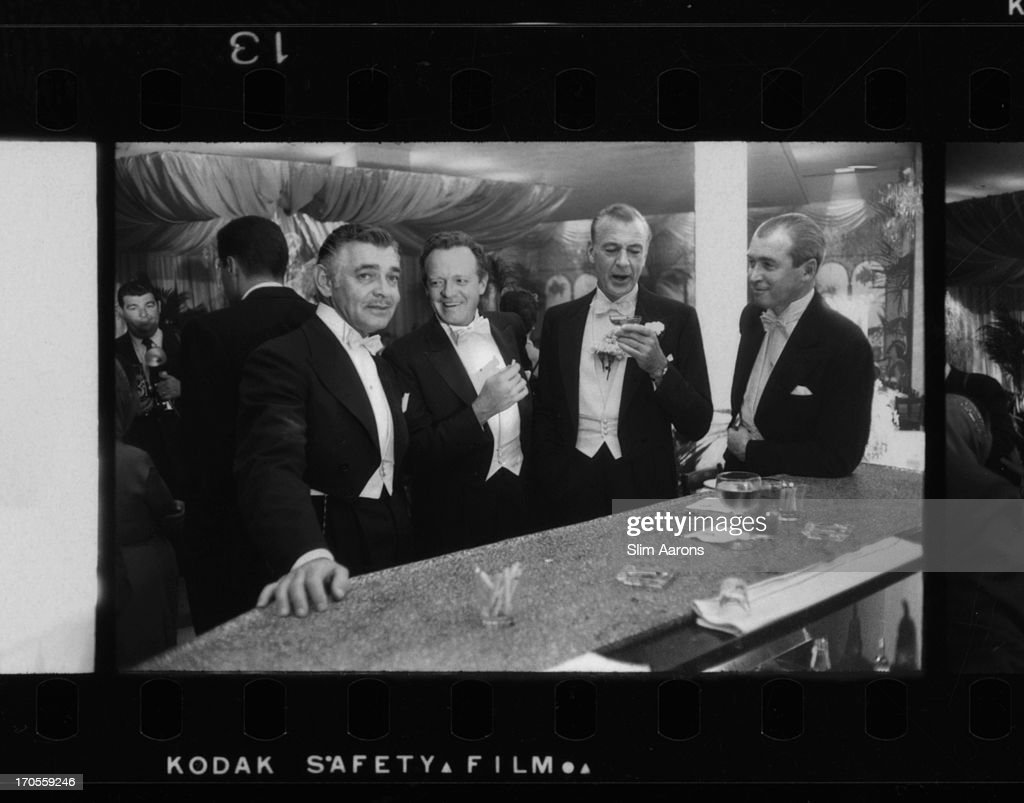 Film stars (left to right) <a gi-track='captionPersonalityLinkClicked' href=/galleries/search?phrase=Clark+Gable&family=editorial&specificpeople=70015 ng-click='$event.stopPropagation()'>Clark Gable</a> (1901 - 1960), <a gi-track='captionPersonalityLinkClicked' href=/galleries/search?phrase=Van+Heflin&family=editorial&specificpeople=220848 ng-click='$event.stopPropagation()'>Van Heflin</a> (1910 - 1971), <a gi-track='captionPersonalityLinkClicked' href=/galleries/search?phrase=Gary+Cooper&family=editorial&specificpeople=93434 ng-click='$event.stopPropagation()'>Gary Cooper</a> (1901 - 1961) and James Stewart (1908 - 1997) enjoy a joke at a New Year's party held at Romanoff's in Beverly Hills.