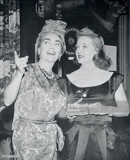 Film stars Joan Crawford and Bette Davis are shown united at party in their honor to celebrate Premier of their new film What Ever Happened To Baby...