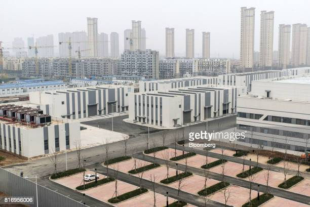 Film studio buildings stand in front of residential buildings in the background inside the Dalian Wanda Group Co Oriental Movie Metropolis project...