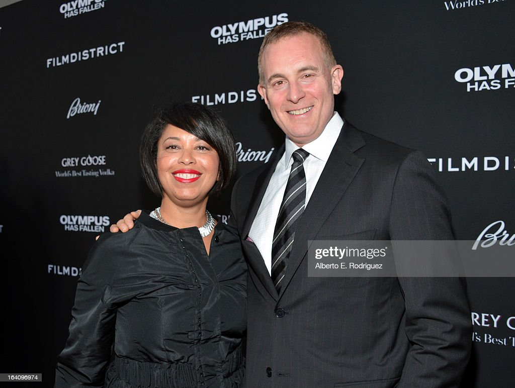 FilmDistrict President of Marketing Christine Birch and FilmDistrict CEO Peter Schlessel arrive at the premiere of FilmDistrict's 'Olympus Has Fallen' at ArcLight Cinemas Cinerama Dome on March 18, 2013 in Hollywood, California.
