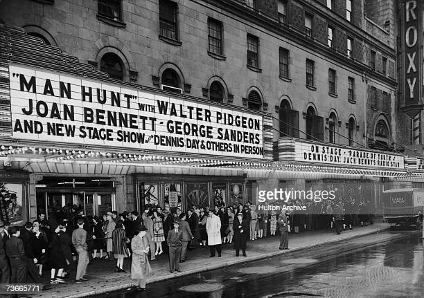 Filmgoers queueing to see Fritz Lang's film 'Man Hunt' outside the Roxy Theater at 153 West 50th Street at 7th Avenue in New York City 1941