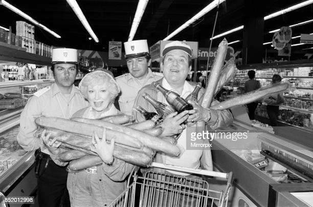 Filming of a series of 'Terry and June' where they go on a day trip to Boulogne they are pictured in a supermarket actress June Whitfield plays June...