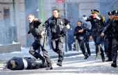 Filming of the Batman movie 'The Dark Knight Rises' at Wall Street Williams St NYC Matthew Modine fires away during a scene But cops say that real...