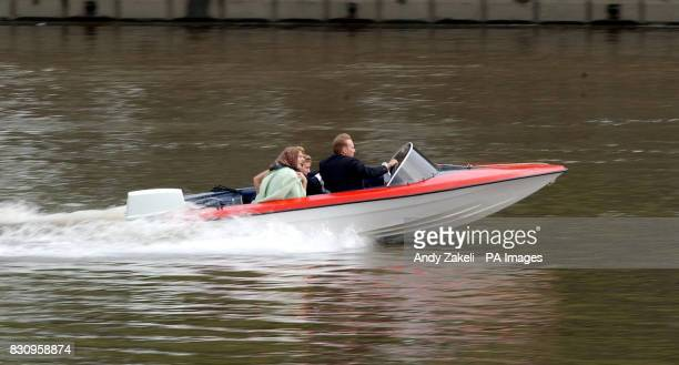Filming of the movie 'Charlie' along the Thames River near Hammersmith Bridge starring Luke Goss pictured driving the boat