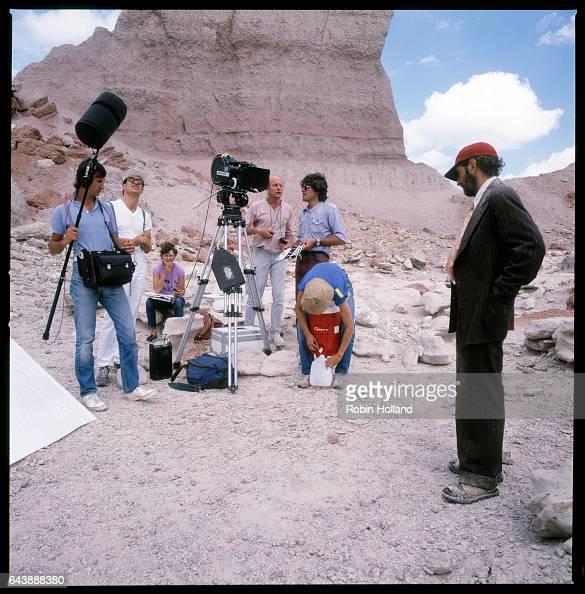 Filming 'Paris Texas' lr JeanPaul Mugel Wim Wenders Helen Caldwell Robbie Muller Pim Tkikeram Agnes Godard and Harry Dean Stanton on the set in...