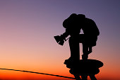 Silhouette of a filming photographer during sunset.More photos:
