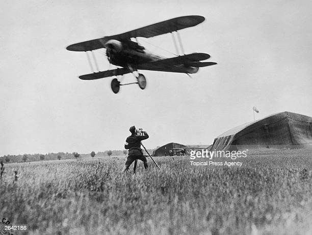 Army cinematographer filming a US Nieuport 28 biplane taking off during the summer counteroffensive