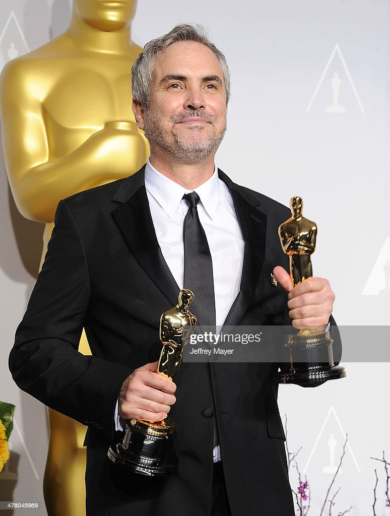 Filmmaker <a gi-track='captionPersonalityLinkClicked' href=/galleries/search?phrase=Alfonso+Cuaron&family=editorial&specificpeople=213792 ng-click='$event.stopPropagation()'>Alfonso Cuaron</a>, winner of Best Achievement in Directing for 'Gravity' poses in the press room during the 86th Annual Academy Awards at Loews Hollywood Hotel on March 2, 2014 in Hollywood, California.