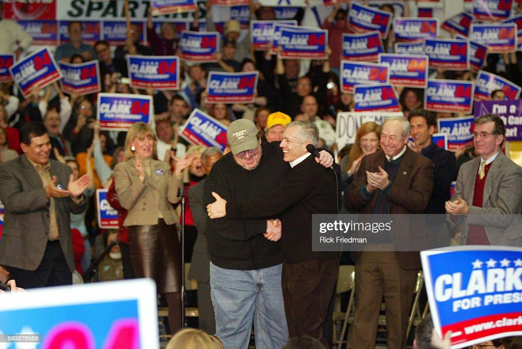 Filmmaker and author Michael Moore embraces Democratic presidential hopeful former General Wesley Clark after endorsing him at Pembroke Academy