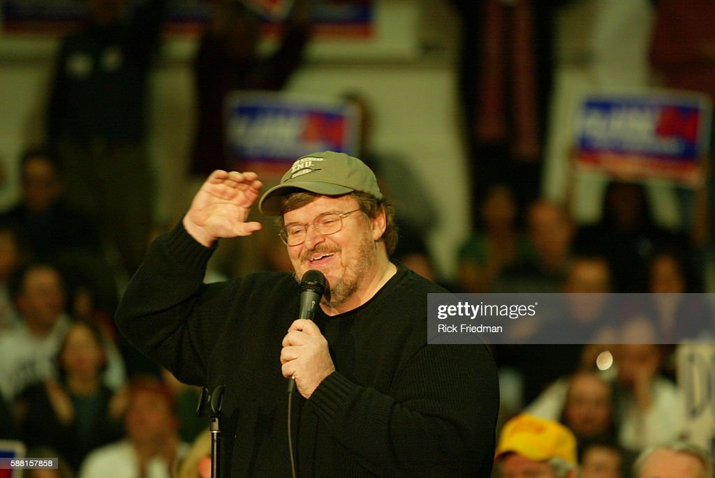 Filmmaker and author Michael Moore speaks to supporters of Democratic presidential hopeful former General Wesley Clark at Pembroke Academy