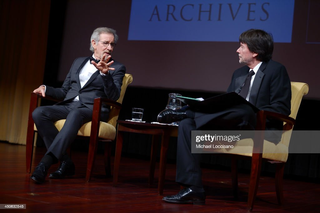 Filmmaker and honoree <a gi-track='captionPersonalityLinkClicked' href=/galleries/search?phrase=Steven+Spielberg&family=editorial&specificpeople=202022 ng-click='$event.stopPropagation()'>Steven Spielberg</a> (L) and Foundation for the National Archives Board Vice President and Gala Chair <a gi-track='captionPersonalityLinkClicked' href=/galleries/search?phrase=Ken+Burns&family=editorial&specificpeople=220451 ng-click='$event.stopPropagation()'>Ken Burns</a> speak onstage at the Foundation for the National Archives 2013 Records of Achievement award ceremony and gala in honor of <a gi-track='captionPersonalityLinkClicked' href=/galleries/search?phrase=Steven+Spielberg&family=editorial&specificpeople=202022 ng-click='$event.stopPropagation()'>Steven Spielberg</a> on November 19, 2013 in Washington, D.C.