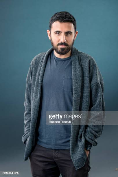 Filmmaker and writer Omar Robert Hamilton attends a photocall during the annual Edinburgh International Book Festival at Charlotte Square Gardens on...