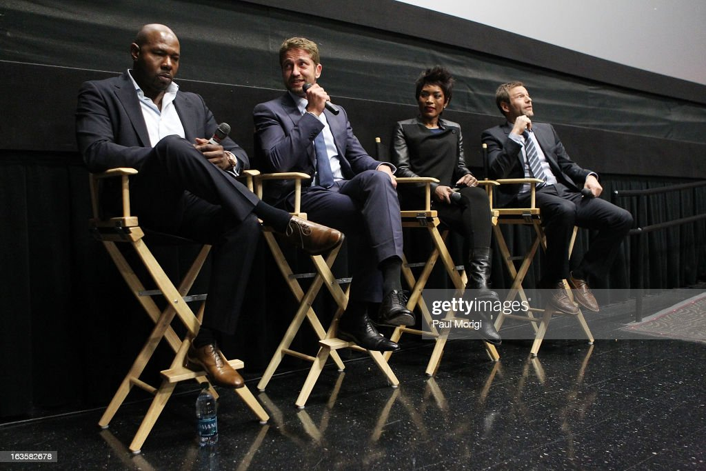 Filmmaker <a gi-track='captionPersonalityLinkClicked' href=/galleries/search?phrase=Antoine+Fuqua&family=editorial&specificpeople=2480782 ng-click='$event.stopPropagation()'>Antoine Fuqua</a>, actors <a gi-track='captionPersonalityLinkClicked' href=/galleries/search?phrase=Gerard+Butler+-+Actor&family=editorial&specificpeople=202258 ng-click='$event.stopPropagation()'>Gerard Butler</a>, <a gi-track='captionPersonalityLinkClicked' href=/galleries/search?phrase=Angela+Bassett&family=editorial&specificpeople=171174 ng-click='$event.stopPropagation()'>Angela Bassett</a> and <a gi-track='captionPersonalityLinkClicked' href=/galleries/search?phrase=Aaron+Eckhart&family=editorial&specificpeople=220602 ng-click='$event.stopPropagation()'>Aaron Eckhart</a> attend the 'Olympus Has Fallen' screening Q & A session at AMC Loews Georgetown 14 on March 12, 2013 in Washington, DC.