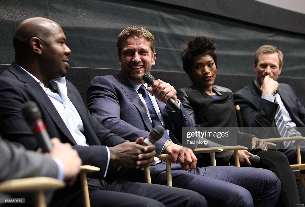 Filmmaker Antoine Fuqua, actors Gerard Butler, Angela Bassett and Aaron Eckhart attend the 'Olympus Has Fallen' screening Q & A session at AMC Loews Georgetown 14 on March 12, 2013 in Washington, DC.