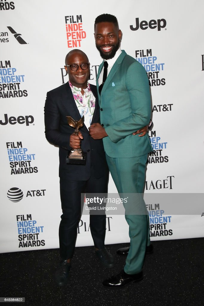 Filmmaker Barry Jenkins (L) and writer Tarell Alvin McCraney, winners of the Best Screenplay award for 'Moonlight,' pose in the press room during the 2017 Film Independent Spirit Awards on February 25, 2017 in Santa Monica, California.