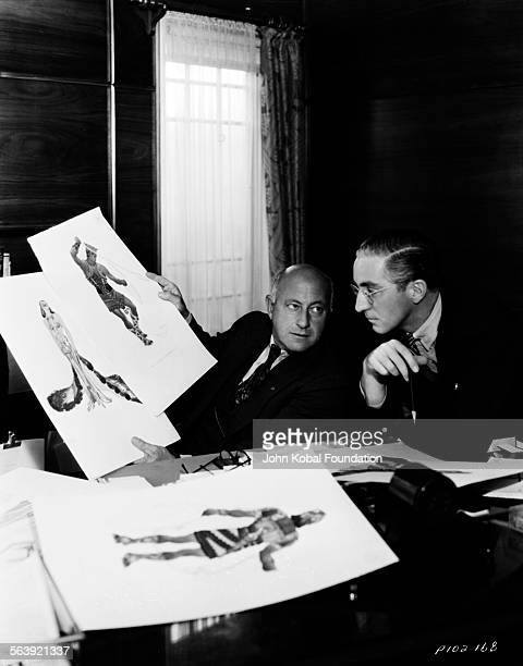 Filmmaker Cecil B DeMille inspecting costume design ideas for the film 'Samson and Delilah' for Paramount Pictures 1949