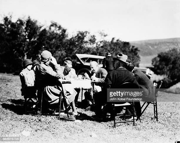 Filmmaker Cecil B DeMille setting up an outdoor dinner scene on the set of the film 'The Squaw Man' for MGM Studios February 11th 1931
