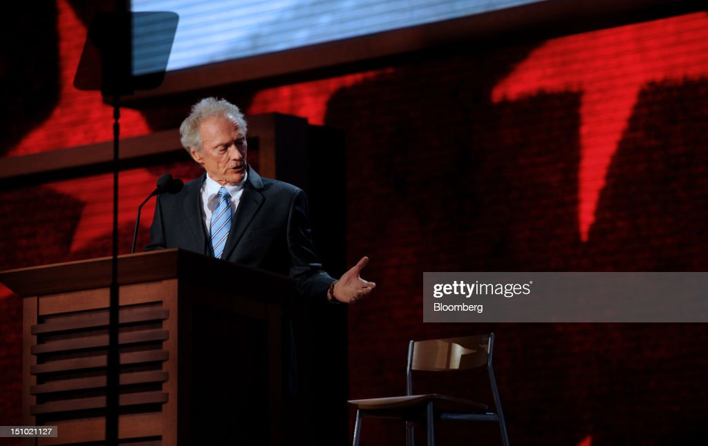 Filmmaker <a gi-track='captionPersonalityLinkClicked' href=/galleries/search?phrase=Clint+Eastwood&family=editorial&specificpeople=201795 ng-click='$event.stopPropagation()'>Clint Eastwood</a> gestures while speaking at the Republican National Convention (RNC) in Tampa, Florida, U.S., on Thursday, Aug. 30, 2012. Republican presidential nominee Mitt Romney, a wealthy former business executive who served as Massachusetts governor and as a bishop in the Mormon church, is under pressure to show undecided voters more personality and emotion in his convention speech tonight, even as fiscal conservatives in his own party say he must more clearly define his plans for reining in the deficit and improving the economy. Photographer: Daniel Acker/Bloomberg via Getty Images