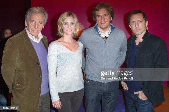Filmmaker CostaGavras actress Natacha Regnier Stephane Celerier CEO of Mars Distribution and actor Gad Elmaleh pose as they attend 'Le Capital'...