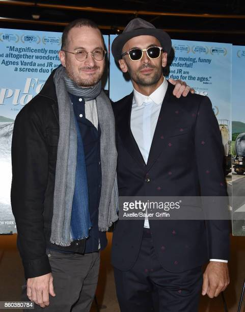 Filmmaker Darren Aronofsky and director JR attend the premiere of Cohen Media Group's 'Faces Places' at the Pacific Design Center on October 11 2017...